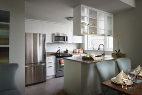 Gourmet kitchens feature high-gloss white cabinetry
