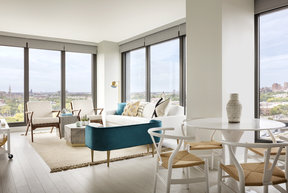 Spacious living rooms have nine-foot ceilings with floor-to-ceiling windows.