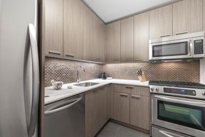 Tribeca Tower features gourmet kitchens with full-sized stainless steel appliances, custom wood cabinetry and white stone countertops.