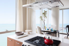 Gourmet kitchens with Snaidero duotone cabinetry and quartz countertops