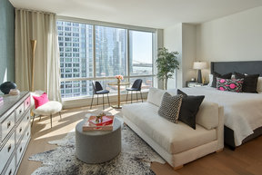 Floor-to-ceiling windows provide maximum natural light and showcase sweeping water and city views