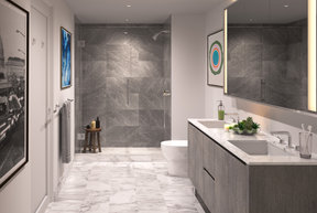 Well-appointed master bathrooms feature double vanities with Italian white marble, grey marble walls, and medicine cabinets with integrated lighting and pulls.