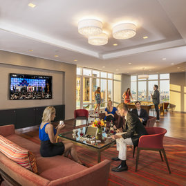Located on the 20th floor with breathtaking Central Park views, the entertainment lounge features a 20-by-60 foot sitting area, billiards, a walnut paneled bar, and Venato Travertine hearth...