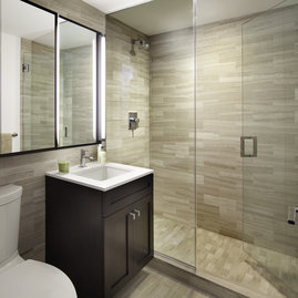 Luxurious bathrooms are clad in marble and include oversize medicine cabinets for easy storage.