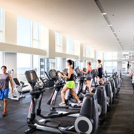 The exclusive resident-only fitness center features a full suite of cardio and weight training equipment along with a separate area for stretching and yoga.