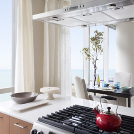 Gourmet kitchens include Snaidero duotone cabinetry, built-in appliances, and quartz countertops.
