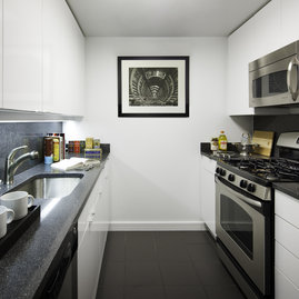 Gourmet kitchens include charcoal stone counters and stainless steel appliances.