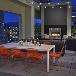 Rooftop terrace with dining tables and BBQ grills.