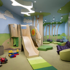 The children's playroom has room for your young explorers to climb, slide, and imagine.