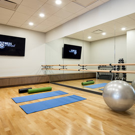 On-site yoga studio space is adjacent to the fitness center.