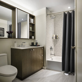 Custom bathrooms include imported Bianco Dolomite polished marble.