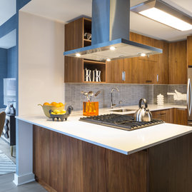 Gleaming countertops and stainless steel appliances in the gourmet kitchen.