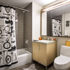Luxurious tiled baths feature custom wood cabinetry and oversized custom-designed medicine cabinets.