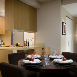 Gourmet kitchens are finished with quartzite stone countertops, sleek bamboo cabinetry, and stainless steel appliances.