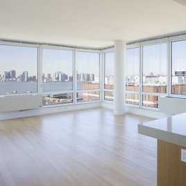 Stunning views of the city and the Hudson River from the expansive windows of The Caledonia.