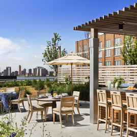 The lushly landscaped outdoor terrace features multiple outdoor dining experiences equipped with BBQ areas for dining as well as a deck high above the eclectic energy of West Chelsea.