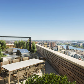 Penthouse sun terraces include reservable BBQ grills and views of the East River.