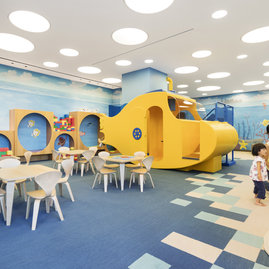 The custom children's play room includes outdoor play space for young explorers.