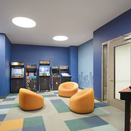 The Easton's residents-only game room includes arcade games, billiards, and a full-service kitchen.