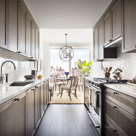 Spacious kitchens include high-end stainless steel refrigerators, gas ranges and integrated dishwasher.