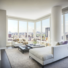 Grand living rooms feature panoranmic city and park views.