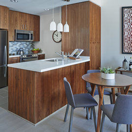 The gracious layouts feature kitchens that open to living and dining space.