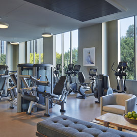 A state-of-the-art fitness center features cardio and strength equipment with an adjacent yoga studio to soothe your senses.
