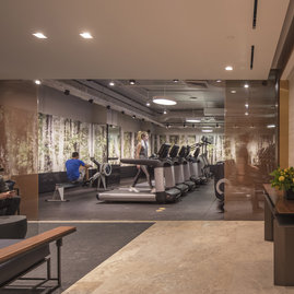 The fitness center includes state-of-the-art equipment curated by Equinox.