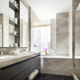 Master bathrooms feature Brazilian quartzite vanities and walls, St. Laurent marble floors, and custom cabinetry.