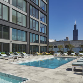 The rooftop sun deck includes a pool, BBQ grills and a fire pit.