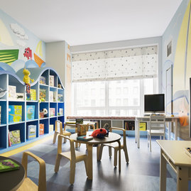 Children's playroom offers in-building space for young ones to explore.