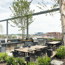 Residents can reserve a private rooftop BBQ area with indoor and outdoor dining spaces (and a fire pit) to enjoy with guests.