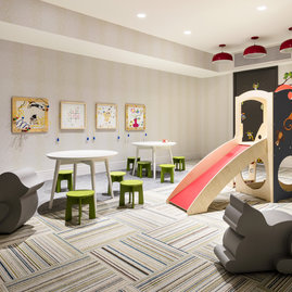 Families enjoy the children's playroom, designed with plenty of space for young explorers to get the wiggles out.