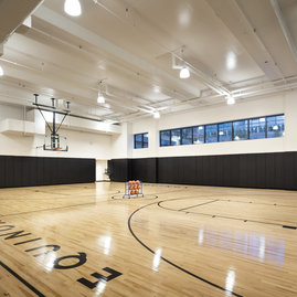 On-site full regulation basketball court.
