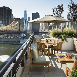 The private, residents-only rooftop sun terrace offers barbeques for dining al fresco.