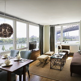 Oversized windows showcase stunning views of the city and the river.