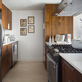 Thoughtful details in the kitchen include gleaming countertops and gas ranges.