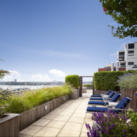 Perfectly planned landscaping on the rooftop terrace offers the ideal location to take in sweeping views of the Hudson River.