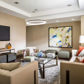 Relax and socialize with friends in an intimate club setting with a large screen TV, open kitchen and lots of comfy chairs.