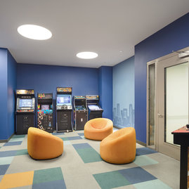 Residents of all ages enjoy private  access to classic arcade games in the game room.