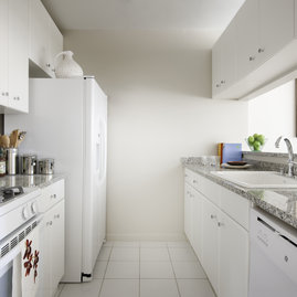 The gourmet kitchens at Tribeca Park include white GE appliances and polished granite countertops.