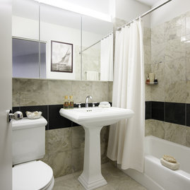 Tribeca Park features elegant marble bathrooms with pedestal sinks and deep shelving in medicine cabinets.