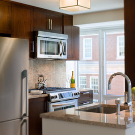 Open kitchens with granite countertops and stainless steel appliances