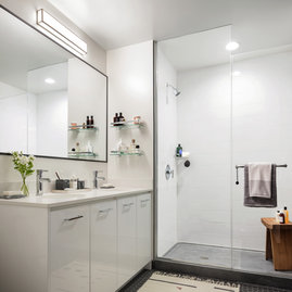 Classically tiled bathrooms feature oversized medicine cabinets.