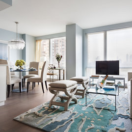 Floor to ceiling windows with sweeping city views