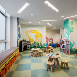Families enjoy the cozy and fanciful children's playroom.