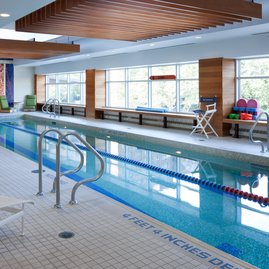 Swim laps in a heated indoor swimming pool with plenty of natural light.