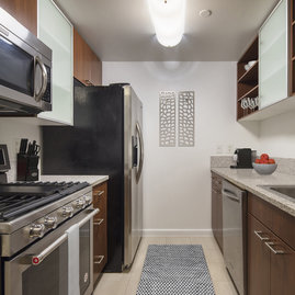 Gourmet granite kitchens with European-style glass door cabinetry, ceramic tile floors and stainless steel appliances will bring out your inner chef.