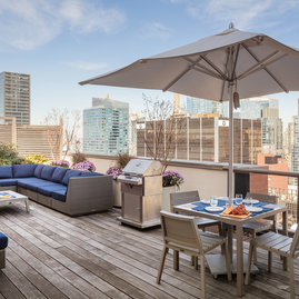 Stunning rooftop includes lounges and BBQ grills.