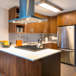 Gourmet kitchens include walnut cabinetry, Caesarstone countertops, and stainless steel KitchenAid® appliances.